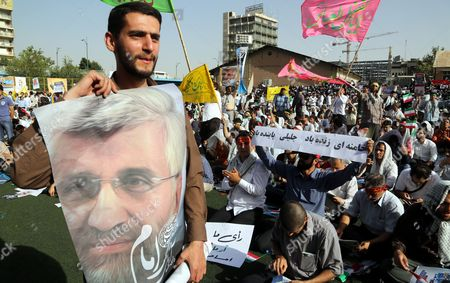 Supporters of Iranian Presidential Candidate Saeed Jalili Hold Posters Depicting Jalili During an Election Campaign Rally Tehran Iran 12 June 2013 Jalili Said He Would Make No Compromise with the West Especially not in the Dispute Over the Country's Controversial Nuclear Programmes Iran Will Hold Presidential Elections on 14 June 2013 Iran (islamic Republic Of) Tehran