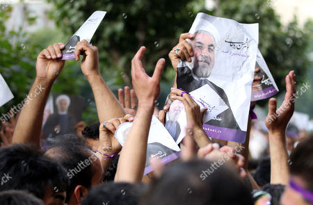 Thousands of Supporter of Newly Elected President Hassan Rouhani Take Part in Street Festivities Right After the Official Announcement of His Victory in Tehran Iran 15 June 2013 Reformist Candidate Hassan Rouhani Has Won Iran's Presidential Election with More Than 50 Per Cent of Votes Interior Minister Mohammad Mostafa Najar Announced Rouhani Outclassed the Other Five Candidates Especially the Two Close to the Establishment: Hardliner Saeid Jalili and Conservative Ali-akbar Velayati Turnout in Friday's Vote was 72 Per Cent Observers Had Said That in Case of a High Turnout Rouhani Would Also Benefit From Protest Votes Iran (islamic Republic Of) Tehran