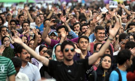 Thousands of Supporters of Newly Elected President Hassan Rouhani Celebrate During Street Festivities Right After the Official Announcement of His Victory in Tehran Iran 15 June 2013 Reformist Candidate Hassan Rouhani Has Won Iran's Presidential Election with More Than 50 Per Cent of Votes Interior Minister Mohammad Mostafa Najar Announced Rouhani Outclassed the Other Five Candidates Especially the Two Close to the Establishment: Hardliner Saeid Jalili and Conservative Ali-akbar Velayati Turnout in Friday's Vote was 72 Per Cent Observers Had Said That in Case of a High Turnout Rouhani Would Also Benefit From Protest Votes Iran (islamic Republic Of) Tehran