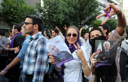 Thousands of Supporters of Newly Elected President Hassan Rouhani Take Part in Street Festivities Right After the Official Announcement of His Victory in Tehran Iran 15 June 2013 Reformist Candidate Hassan Rouhani Has Won Iran's Presidential Election with More Than 50 Per Cent of Votes Interior Minister Mohammad Mostafa Najar Announced Rouhani Outclassed the Other Five Candidates Especially the Two Close to the Establishment: Hardliner Saeid Jalili and Conservative Ali-akbar Velayati Turnout in Friday's Vote was 72 Per Cent Observers Had Said That in Case of a High Turnout Rouhani Would Also Benefit From Protest Votes Iran (islamic Republic Of) Tehran