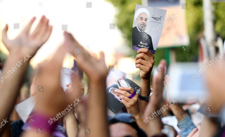 Thousands of Supporters of Newly Elected President Hassan Rouhani Participate in Street Festivities Right After the Official Announcement of His Victory Tehran Iran 15 June 2013 Reformist Candidate Hassan Rouhani Has Won Iran's Presidential Election with More Than 50 Per Cent of Votes Interior Minister Mohammad Mostafa Najar Announced Rouhani Outclassed the Other Five Candidates Especially the Two Close to the Establishment: Hardliner Saeid Jalili and Conservative Ali-akbar Velayati Turnout in Friday's Vote was 72 Per Cent Observers Had Said That in Case of a High Turnout Rouhani Would Also Benefit From Protest Votes Iran (islamic Republic Of) Tehran