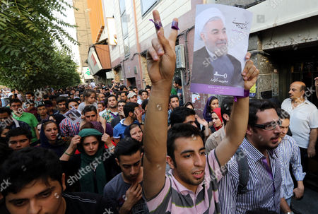Thousands of Supporters of Newly Elected President Hassan Rouhani Take Part in Street Festivities Right After the Official Announcement of His Victory Tehran Iran 15 June 2013 Reformist Candidate Hassan Rouhani Has Won Iran's Presidential Election with More Than 50 Per Cent of Votes Interior Minister Mohammad Mostafa Najar Announced Rouhani Outclassed the Other Five Candidates Especially the Two Close to the Establishment: Hardliner Saeid Jalili and Conservative Ali-akbar Velayati Turnout in Friday's Vote was 72 Per Cent Observers Had Said That in Case of a High Turnout Rouhani Would Also Benefit From Protest Votes Iran (islamic Republic Of) Tehran