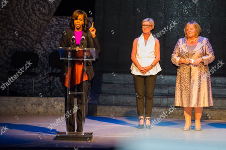 First Lady Michelle Obama (l) Next to Producer of 'Riverdance' Moya Doherty (c) and Wife of Irish Prime Minister Enda Kenny Fionnuala Kenny (r) Points As She Speaks at Dublin's Gaiety Theatre During Her Visit with Her Daughters at the Theater For a Special Performance of Riverdance in Dublin Ireland 17 June 2013 Ireland Dublin
