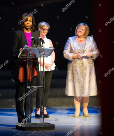 First Lady Michelle Obama (l) Standing Next to Producer of 'Riverdance' Moya Doherty (c) and Wife of Irish Prime Minister Enda Kenny Fionnuala Kenny (r) Speaks at Dublin's Gaiety Theatre During Her Visit with Her Daughters at the Theater For a Special Performance of Riverdance in Dublin Ireland 17 June 2013 Ireland Dublin