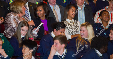 Wife of Irish Prime Minister Enda Kenny Fionnuala Kenny (l) First Lady Michelle Obama (2-l) and Daughters Malia (2-r) and Sasha (r) Sit in the Audience During a Special Performance of Riverdance at the Dublin's Gaiety Theatre in Dublin Ireland 17 June 2013 Ireland Dublin