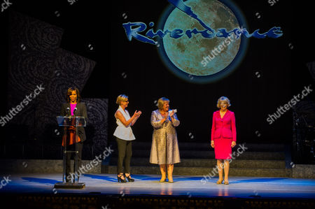 First Lady Michelle Obama (l) Producer of 'Riverdance' Moya Doherty (2-l) Wife of Irish Prime Minister Enda Kenny Fionnuala Kenny (2-r) and Wife of Irish President Michael D Higgins Sabina Higgins (r) Stand on Stage During Michelle's Visit with Her Daughters at the Theater For a Special Performance of Riverdance in Dublin Ireland 17 June 2013 Ireland Dublin