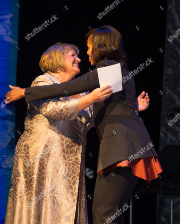 Wife of Irish Prime Minister Enda Kenny Fionnuala Kenny (l) Hugs First Lady Michelle Obama (r) As Michelle and Daughters Malia and Sasha (both not Pictured) Visit the Dublin's Gaiety Theatre For a Special Performance of Riverdance Dublin Ireland 17 June 2013 Ireland Dublin