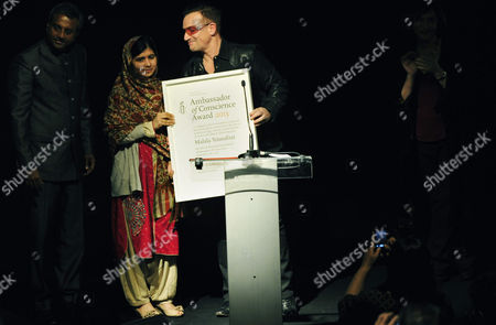 Irish Musician Paul David Hewson Aka Bono (r) of the Band U2 Hands Over a Certificate to Pakistani Citizen Malala Yousafzai (c) As She Receives Her Amnesty International Ambassador of Conscience Award During a Ceremony in Dubllin Ireland 17 September 2013 Malala was Attacked by Taliban on 09 October 2012 For Advocating Girls Rights to Education and Wounded Along with Two Schoolmates Ireland Dublin
