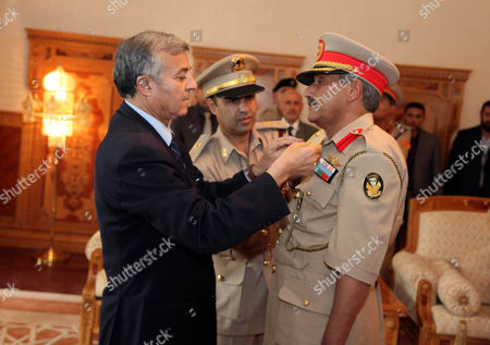 The New Chief of Staff of the Libyan Armed Forces Colonel Abdulsalam Jadallah (r) is Appointed by Chairman of the Libyan General National Congress Nouri Abusahmain (l) in Tripoli Libya 30 July 2013 Libya's New Military Chief of Staff - Appointed by Parliament on 30 July - is a Commander who Fought During the 2011 Conflict That Ousted Former Leader Muammar Gaddafi State Television Reported Colonel Abdulsalam Jadallah Al-salheen Replaces General Youssef Al-mangoush who Resigned in June After More Than 30 People Were Killed in Clashes Between a Militia Group and Protesters in the Eastern City of Benghazi Libyan Arab Jamahiriya Tripoli