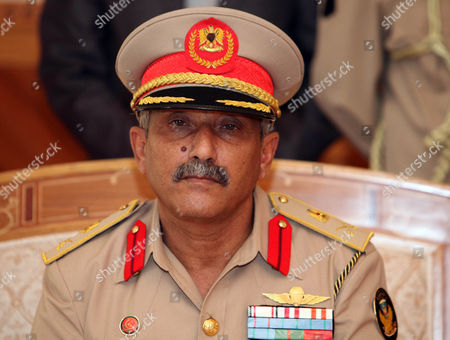 The New Chief of Staff of the Libyan Armed Forces Colonel Abdulsalam Jadallah After Being Appointed by Chairman of the Libyan General National Congress Nouri Abusahmain (not Pictured) in Tripoli Libya 30 July 2013 Libya's New Military Chief of Staff - Appointed by Parliament on 30 July - is a Commander who Fought During the 2011 Conflict That Ousted Former Leader Muammar Gaddafi State Television Reported Colonel Abdulsalam Jadallah Al-salheen Replaces General Youssef Al-mangoush who Resigned in June After More Than 30 People Were Killed in Clashes Between a Militia Group and Protesters in the Eastern City of Benghazi Libyan Arab Jamahiriya Tripoli