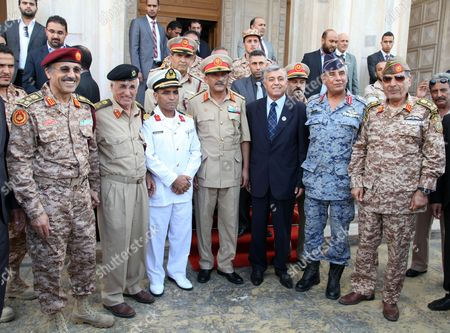 The New Chief of Staff of the Libyan Armed Forces Colonel Abdulsalam Jadallah (4-r Front Row) After Being Appointed by Chairman of the Libyan General National Congress Nouri Abusahmain (3-r Front Row) Pose with Chiefs of the Armed Forces in Tripoli Libya 30 July 2013 Libya's New Military Chief of Staff - Appointed by Parliament on 30 July - is a Commander who Fought During the 2011 Conflict That Ousted Former Leader Muammar Gaddafi State Television Reported Colonel Abdulsalam Jadallah Al-salheen Replaces General Youssef Al-mangoush who Resigned in June After More Than 30 People Were Killed in Clashes Between a Militia Group and Protesters in the Eastern City of Benghazi Libyan Arab Jamahiriya Tripoli