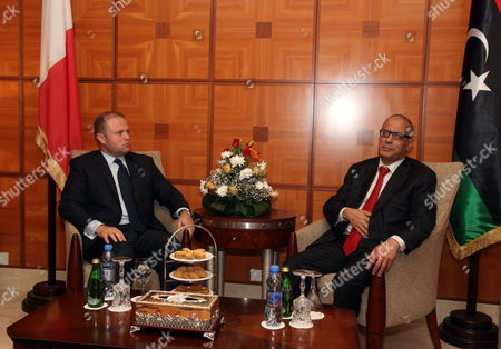 Libyan Prime Minister Ali Zeidan (r) Meets with His Maltese Counterpart Joseph Muscat (l) in Tripoli Libya 13 October 2013 Muscat Visits Libya Following the Latest Shipwreck Leading to the Death of Migrants South of Malta and Lampedusa on 11 October Which Came After Another on 03 October That Led to the Deaths of at Least 350 Migrants 'I Don't Know How Many More People Need to Die at Sea Before Something Gets Done ' Muscat Said in an Interview with the Bbc on 12 October 'As Things Stand We Are Building a Cemetery Within Our Mediterranean Sea ' He Added Libyan Arab Jamahiriya Tripoli