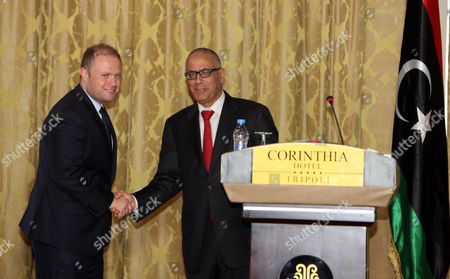 Libyan Prime Minister Ali Zeidan (r) Shakes Hands with His Maltese Counterpart Joseph Muscat (l) After a Joint Press Conference in Tripoli Libya 13 October 2013 Muscat Visits Libya Following the Latest Shipwreck Leading to the Death of Migrants South of Malta and Lampedusa on 11 October Which Came After Another on 03 October That Led to the Deaths of at Least 350 Migrants 'I Don't Know How Many More People Need to Die at Sea Before Something Gets Done ' Muscat Said in an Interview with the Bbc on 12 October 'As Things Stand We Are Building a Cemetery Within Our Mediterranean Sea ' He Added Libyan Arab Jamahiriya Tripoli