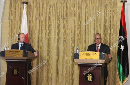 Libyan Prime Minister Ali Zeidan (r) and His Maltese Counterpart Joseph Muscat (l) Speak During a Joint Press Conference in Tripoli Libya 13 October 2013 Muscat Visits Libya Following the Latest Shipwreck Leading to the Death of Migrants South of Malta and Lampedusa on 11 October Which Came After Another on 03 October That Led to the Deaths of at Least 350 Migrants 'I Don't Know How Many More People Need to Die at Sea Before Something Gets Done ' Muscat Said in an Interview with the Bbc on 12 October 'As Things Stand We Are Building a Cemetery Within Our Mediterranean Sea ' He Added Libyan Arab Jamahiriya Tripoli