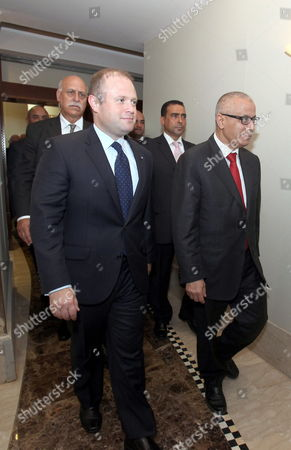 Libyan Prime Minister Ali Zeidan (r) and His Maltese Counterpart Joseph Muscat (l) During Their Meeting in Tripoli Libya 13 October 2013 Muscat Visits Libya Following the Latest Shipwreck Leading to the Death of Migrants South of Malta and Lampedusa on 11 October Which Came After Another on 03 October That Led to the Deaths of at Least 350 Migrants 'I Don't Know How Many More People Need to Die at Sea Before Something Gets Done ' Muscat Said in an Interview with the Bbc on 12 October 'As Things Stand We Are Building a Cemetery Within Our Mediterranean Sea ' He Added Libyan Arab Jamahiriya Tripoli