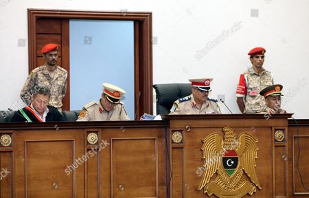 Stock Image of Libyan Military High Court Judges Preside Over the Appeal of 24 Defendants From Russia Ukraine and Belarus in Tripoli Libya 14 August 2013 the Defendants Were Convicted For Collaboration with Ousted Muammar Qaddafi an Appeal Hearing Held the Same Day Turned Their Case to a Civilian Court Libyan Arab Jamahiriya Tripoli