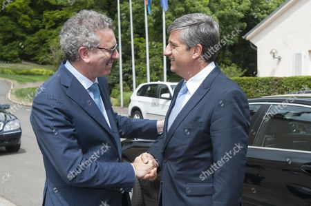 Luxembourg Finance Minister Pierre Gramegna (l) Greets Austrian Finance Minister Michael Spindelegger (r) Prior to the German Speaking Countries's Finance Ministers Meeting in Senningen Castel Luxembourg 20 June 2014 the Ministers Will Discuss on the Finance Situation Between Austria Lichtenstein Luxembourg Germany and Swizterland in Particular the Taxes Data Exchange Luxembourg Luxembourg