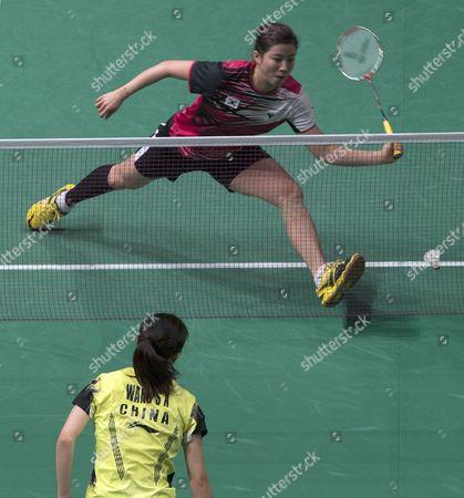 Bae Yeon Ju (up) of South Korea in Action Against Wang Shixian of China During the Women's Single Semi Final Match of the Badminton Malaysian Open at Putra Stadium in Kuala Lumpur Malaysia 18 January 2014 Malaysia Kuala Lumpur