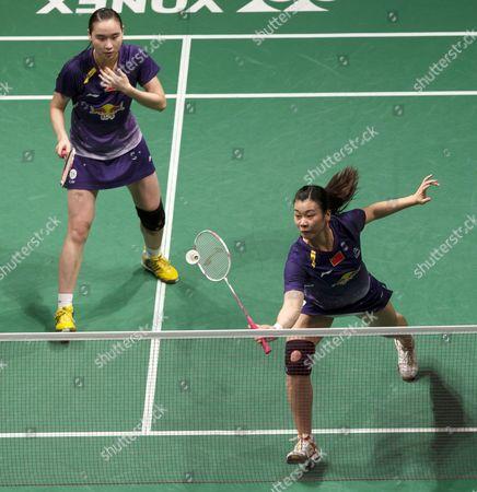 Bao Yixin (l) and Tang Jinhua of China in Action During a Match Against Misaki Matsutomo and Ayaka Takahashi of Japan During the Women's Double Final Match of the Badminton Malaysian Open at Putra Stadium in Kuala Lumpur Malaysia 19 January 2014 Malaysia Kuala Lumpur