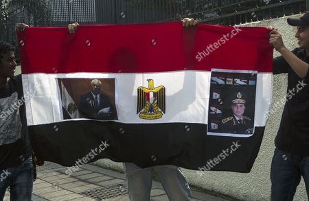 Opponents of Ousted Egyptian President Mohamed Morsi Hold an Egyptian Flag with a Picture Interim President Adli Mansour (l) and Egyptian Defense Minister Abdel-fatah Al-sisi Outside Egyptian Embassy in Kuala Lumpur Malaysia 26 July 2013 Egypt's Army Has Given Supporters of Ousted Islamist President Mohammmed Morsi 48 Hours to Join 'National Ranks' Or Face an Expected Crackdown Malaysia Kuala Lumpur