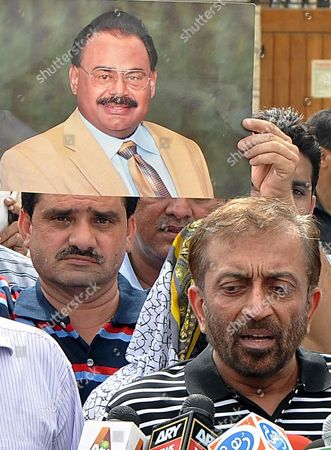 Stock Photo of Farooq Sattar (c) a Member of the National Assembly (lower House of the Parliament) and Leader of Opposition Party Mutahida Qaumi Movement (mqm) Talks with Journalists Outiside the British Consulate in Karachi Pakistan 30 June 2013 Altaf Hussain who Runs the Party From London where He Lived in Self-exile For Decades Had Resigned Voluntarily From the Party After British Security Officials Raided One of His Homes in Connection with the Murder of One Imran Farooq the Muttahida Qaumi Movement Formerly Known As Mohajir Qaumi Movement was Formed by Current Leader Altaf Hussain to Fight For the Rights of Urdu Speakers in Karachi the Country's Most-populous City It is a Secular Left-leaning Party and Relies Almost Exclusively on Urdu-speaking Voters From the Ethnically Diverse City of 18 Million Which Has Seen Deadly Sectarian Clashes in Recent Years Pakistan Karachi