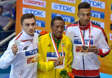 Stock Photo of (l-r) Silver Medalist Adam Kszczot of Poland Gold Medalist Mohammed Aman of Ethiopia Bronze Medalist Andrew Osagie of Britain on the 800m Men Winners' Podium at the End of the Men's Pole Vault at the Athletics World Indoor Championships at Ergo Arena in Sopot Poland 09 March 2014 Poland Sopot