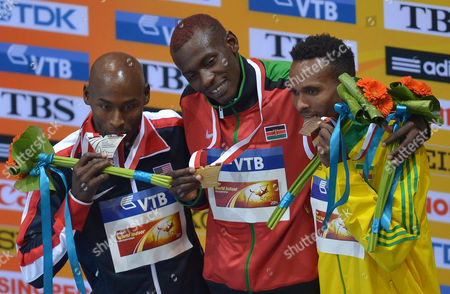 (from L-r) Silver Medalist Bernard Lagat of the Usa Golden Medal Celeb Mwangangi Ndiku of Kenya and Bronze Medal Dejan Gebremeskel of Ethiopia Celebrate on Winners' Podium at the End of the Men's 3000m Men at the Athletics World Indoor Championships at Ergo Arena in Sopot Poland 09 March 2014 Poland Sopot