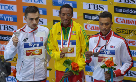 (l-r) Silver Medalist Adam Kszczot of Poland Gold Medalist Mohammed Aman of Ethiopia Bronze Medalist Andrew Osagie of Britain on the 800m Men Winners' Podium at the End of the Men's Pole Vault at the Athletics World Indoor Championships at Ergo Arena in Sopot Poland 09 March 2014 Poland Sopot