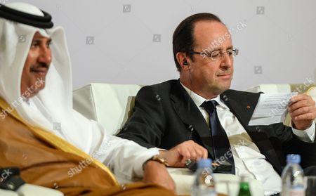 French President Francois Hollande ( R) and Qatar Prime Minister and Foreign Minister He Sheikh Hamad Bin Jassim Bin Jaber Al-thani ( L) Attend the French - Qatari Economic Forum at Four Season Hotel Doha-qatar on 23 June 2013 Qatar Doha