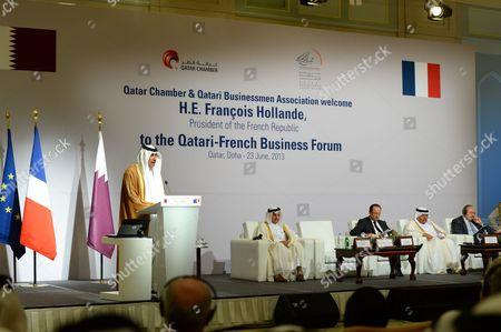 Stock Picture of Qatar Prime Minister and Foreign Minister He Sheikh Hamad Bin Jassim Bin Jaber Al-thani ( L) Speaks During the French - Qatari Economic Forum at Four Season Hotel Doha-qatar on 23 June 2013 Qatar Doha