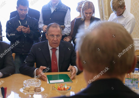 Russian Foreign Minister Sergei Lavrov (sitting L) Speaks with Australian Foreign Minister Bob Carr (sitting R) During Their Meeting in Moscow Russia 03 September 2013 Russian Federation Moscow