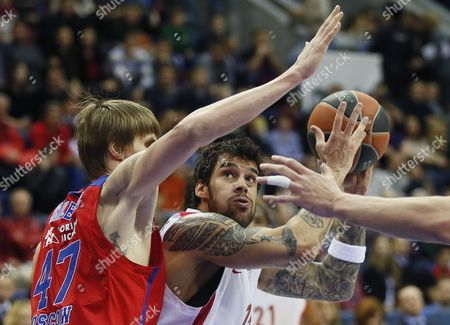 Georgios Printezis (r) of Olympiacos in Action Against Andrei Kirilenko of Cska Moscow During Their Basketball Euroleague Match in Moscow Russia 03 April 2015 Russian Federation Moscow