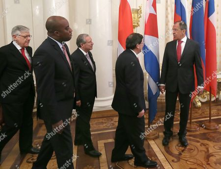 Russian Foreign Minister Sergei Lavrov (r) Enters a Hall with Haitian Foreign Minister Richard Casimir (2nd-l) Cuban Foreign Minister Bruno Eduardo Rodriguez (2nd-r) Costa Rican Foreign Minister Enrique Castillo (c) and Chilean Deputy Foreign Minister Fernando Schmidt Aritzia (l) During Meeting of the Foreign Ministers of the Member States of the Community of Latin American and Caribbean States (celac) in Moscow Russia 29 May 2013 Russian Federation Moscow