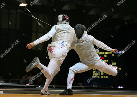 Giorgio Avola (l) of Italy Fights with Yuki Ota (r) of Japan During Their Men's Foil Round of 64 Match at the Fei 2014 Fencing World Championships in Kazan Russia 19 July 2014 Russian Federation Kazan