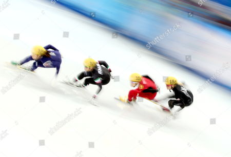 (l-r) Shim Suk Hee of South Korea Arianna Fontana of Italy Kexin Fan of China Emily Scott of the Usa During a Short Track 1000m Quarter Final Event in the Iceberg Skating Palace at the Sochi 2014 Olympic Games Sochi Russia 21 February 2014 Russian Federation Sochi
