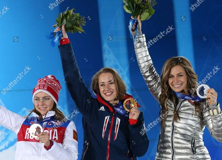 Gold Medalist Elizabeth Yarnold (c) of Great Britain is Flanked by Silver Medalist Noelle Pikus-pace (r) of Usa and Bronze Winner Elena Nikitina of Russia During the Medal Ceremony For Women's Skeleton Event at the Sochi 2014 Olympic Games Sochi Russia 15 February 2014 Russian Federation Sochi