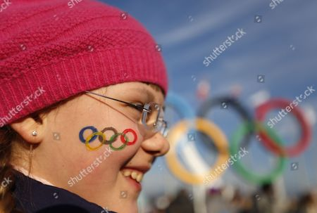 Ten-year-old Anastasia Baranova is Seen with the Olympic Rings Painted on Her Face at the Olympic Park During the Sochi 2014 Olympic Games Sochi Russia 14 February 2014 Russian Federation Sochi