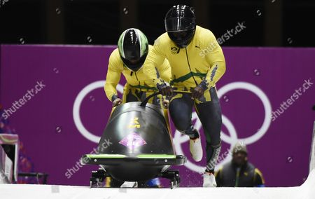 Winston Watts (r) and Marvin Dixon of Jamaica at the Start of the Third Run in the Two-man Bobsleigh Competition at the Sanki Sliding Center at the Sochi 2014 Olympic Games Krasnaya Polyana Russia 17 February 2014 Russian Federation Krasnaya Polyana