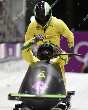 Winston Watts (front) and Marvin Dixon of Jamaica at the Start of the Third Run in the Two-man Bobsleigh Competition at the Sanki Sliding Center at the Sochi 2014 Olympic Games Krasnaya Polyana Russia 17 February 2014 Russian Federation Krasnaya Polyana