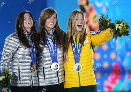 Stock Image of Gold Medalist Kaitlyn Farrington (c) of Usa is Flanked by Silver Medalist Torah Bright (r) of Australia and Bronze Medalist Kelly Clark of Usa During the Medal Ceremony For Snowboard Women's Halfpipe Event at the Sochi 2014 Olympic Games Sochi Russia 13 February 2014 Russian Federation Sochi