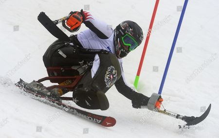 Claudia Loesch of Austria in Action During the Women's Super Combined Sitting Slalom Race of the Alpine Skiing Events at Rosa Khutor Alpine Center During the Sochi 2014 Paralympic Winter Games in Krasnaya Polyana Russia 11 March 2014 Russian Federation Krasnaya Polyana