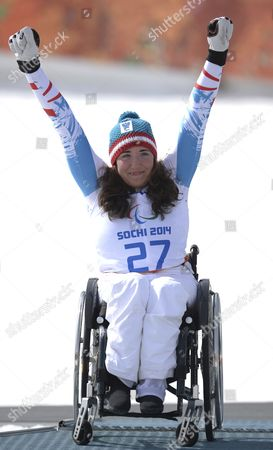 Silver Medalist Claudia Loesch of Austria Celebrates on the Podium During the Flower Ceremony For the Women's Alpine Skiing Super G Sitting Race in the Rosa Khutor Alpine Center at the Sochi 2014 Paralympic Games Krasnaya Polyana Russia 10 March 2014 Russian Federation Krasnaya Polyana