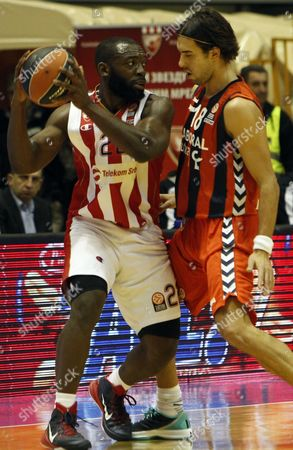 Stock Image of Charles Jenkins (l) of Red Star in Action Against Sasha Vujacic (r) of Laboral Kutxa Vitoria During the Euroleague Basketball Match Between Red Star and Laboral Kutxa Vitoria in Belgrade Serbia 19 December 2014 Serbia and Montenegro Belgrade