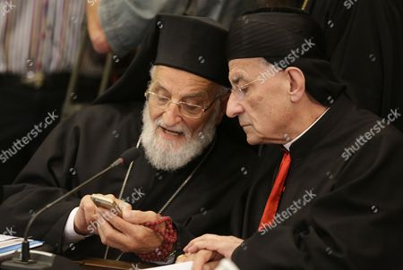 Maronite Patriarch Bechara Rai (r) and Spiritual Leader of the Melkite Greek Catholic Church the Patriarch of Antioch Gregory Iii Laham (l) Look at a Mobile Phone During a Spiritual Meeting of the Patriarchs of Antioch and All East at the Greek Patriarchate of Damascus Syria 08 June 2015 Syrian Arab Republic Damscus