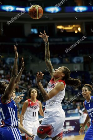 Stock Picture of Usa's Seimone Augustus (c) in Action Against France's Emilie Gomis (l) During the 2014 Fiba World Championship For Women Quarter Final Match Between Usa and France in Istanbul Turkey 03 October 2014 Turkey Istanbul
