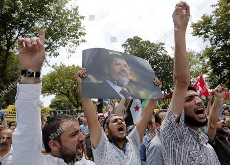 Protestors Hold Pictures of Ousted Egyptian President Mohamed Morsi and Shout Slogans During Pro-morsi Rally After Friday Pray at Fatih Mosque in Istanbul Turkey 05 July 2013 Egypt's Muslim Brotherhood Has Called For Mass Rallies to Protest the Army's Overthrow of Morsi and a Crackdown on Other Senior Members of the Movement Adli Mansour the Chief of Egypt's Highest Court was Sworn in on 04 July As Egypt's Interim President After the Ousting of Morsi Turkey Istanbul