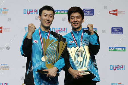 Lee Yong Dae and Yoo Yeon Seong From South Korea Hold Their Trophys After Winning Against Chai Biao and Hong Wei From China During Their Men's Double Final Match of the Bwf Destination Dubai World Superseries Finals at the Hamdan Sports Complex in Dubai United Arab Emirates on 21 December 2014 United Arab Emirates Dubai