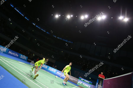 Chai Biao and Hong Wei From China in Action Against Lee Yong Dae and Yoo Yeon Seong From South Korea During Their Men's Double Final Match of the Bwf Destination Dubai World Superseries Finals at the Hamdan Sports Complex in Dubai United Arab Emirates on 21 December 2014 United Arab Emirates Dubai