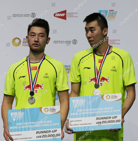 Chai Biao and Hong Wei From China Pose with Their Silver Medals After Losing Against Lee Yong Dae and Yoo Yeon Seong From South Korea During Their Men's Double Final Match of the Bwf Destination Dubai World Superseries Finals at the Hamdan Sports Complex in Dubai United Arab Emirates on 21 December 2014 United Arab Emirates Dubai
