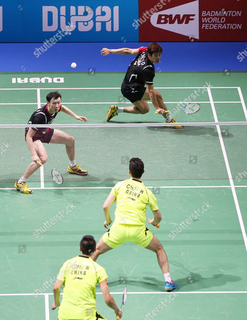 Lee Yong Dae and Yoo Yeon Seong(back) From South Korea in Action Against Chai Biao and Hong Wei (front) From China During Their Men's Double Final Match of the Bwf Destination Dubai World Superseries Finals at the Hamdan Sports Complex in Dubai United Arab Emirates on 21 December 2014 United Arab Emirates Dubai